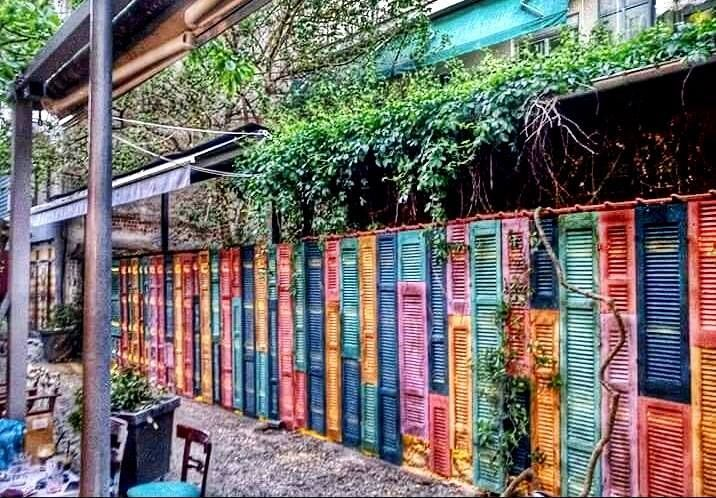 """Gorgeous Shutter Wall in an outdoor cafe, all painted in Chalk Paint® by Serres, Northern Greece Stockist Creations """"by mael"""" Painted in Arles, Provence, Scandinavian Pink, Aubusson and Henrietta Chalk Paint®."""