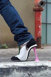 yet another one of Kobi Levi's crazy shoe designs. Yes, these are heels that look like gum stuck to tennis shoes