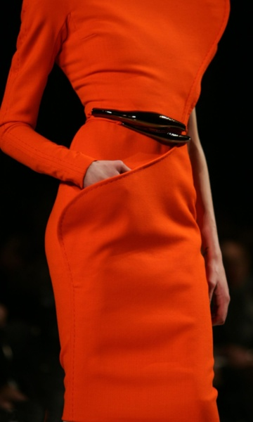 ...  awesome detail slicing the pocket and then piping on an almost diagonal line across the skirt..... love clever design!