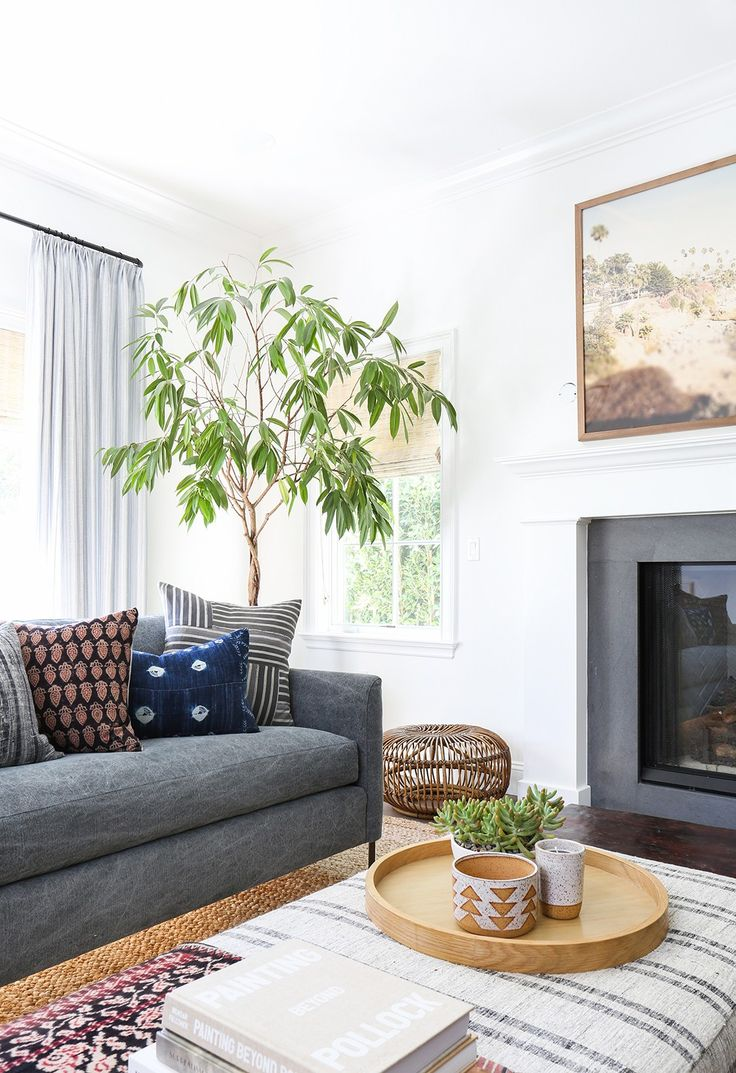 More gray couch on jute rug.   Home Tour: A Modern Bohemian Family Abode via @MyDomaine