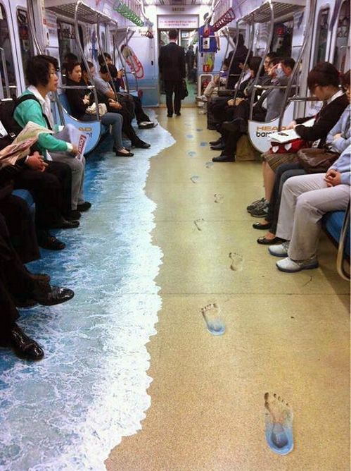 subway floor art...I would feel compelled to walk in the footsteps. This is in a Korean subway and is an ad for HEAD's barefoot range of sports shoes—'they feel like you're walking in bare feet'.