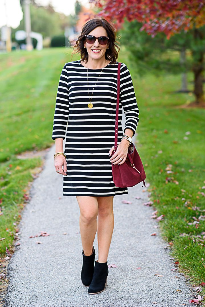 Black and White Striped Dress Outfit for Fall with Ankle Boots