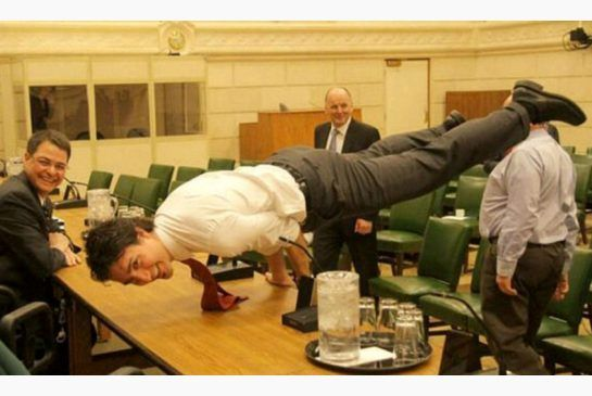 Justin Trudeau, Canada's new Prime Minister in peacock yoga pose.