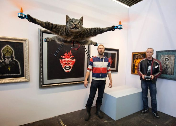 """Dutch artist Bart Jansen turned his deceased feline friend Orville into an RC helicopter piece of art called """"Orvillecopter."""" After the cat was run over by a car, Jansen taxidermically prepared his pet, placed the electronics in its belly, and a rotor in each paw to create this fully functioning remote controlled kittycopter. Jansen sold Orvillecopter for 12,000 EUR"""