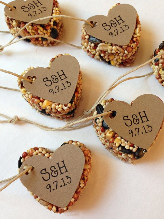 Heart-shaped bird seed feeder gift favors for guests. Card stock with verse; perhaps Matthew 6:26 about God feeding the birds.