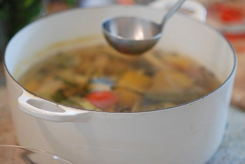 """""""A court-bouillon is an aromatic liquid or stock made with everything from simple sea salt to thyme, bay leaf, cloves, peppercorns, onion, carrot, celery, parsley, milk, wine, lemon or vinegar. When cooked gently in a court-bouillon, delicate foods. notably fish and other shellfish, as well as eggs, veal & chicken, absorb a hint of the liquid's flavor..."""""""