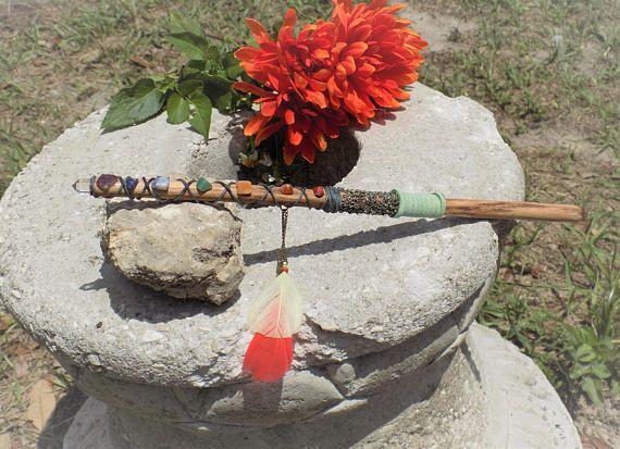 This is a one of a kind, handmade wooden wand created and charged by Psychic Miss Toria herself. The wand measures 11 inches long.  At the tip of the wand is a pointed quartz crystal. Along the wand is a complete chakra stone set.  Around the center of the wand is real crushed pyrite.  #wiccan #wicca #pagan #wand #witchcraft #occult #witch #magic