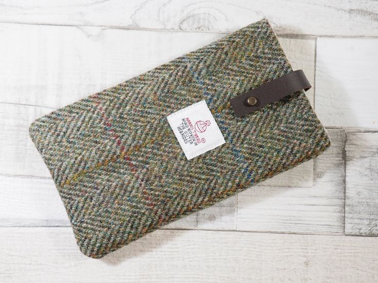 Harris Tweed Phone Sleeve in bracken/brown herringbone tweed with leather closure, suitable for Samsung Galaxy S6 or iPhone 6 sized phones by HandbagsandHome on Etsy