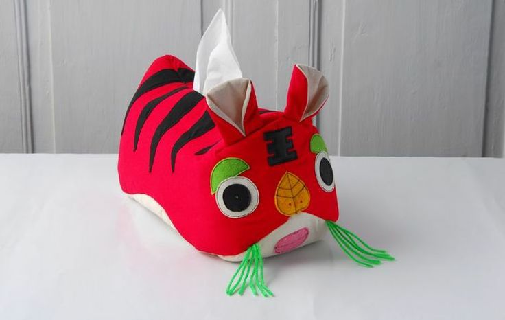 Tissue box holder based on a traditional tiger in Chinese culture.