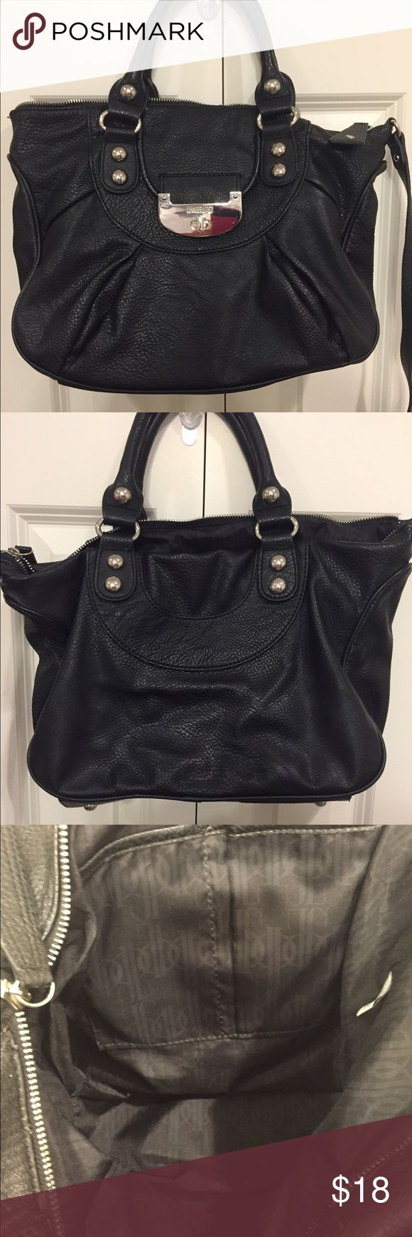 Jennifer Lopez Black Leather Purse This purse is in excellent condition other than the shoulder strap has come out on one side. Could most likely be repaired though since it just came out of the stitching (see picture four). You could either repair or just use the shorter handles. Still totally functional purse. There is an outer pouch under Jennifer Lopez plate and a couple small inside ones. Jennifer Lopez Bags