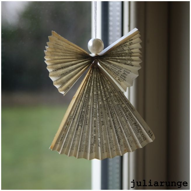 A little angel made out of pages from a hymn book. Would love these on my Christmas tree!