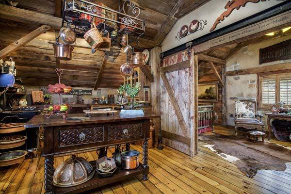 A reclaimed barn door slides between the upstairs kitchen and master bedroom. | Photo: Bill Matthews