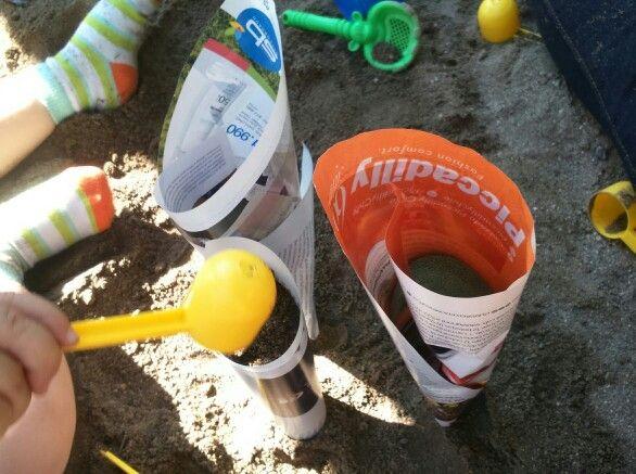 Juego reciclaje en la arena