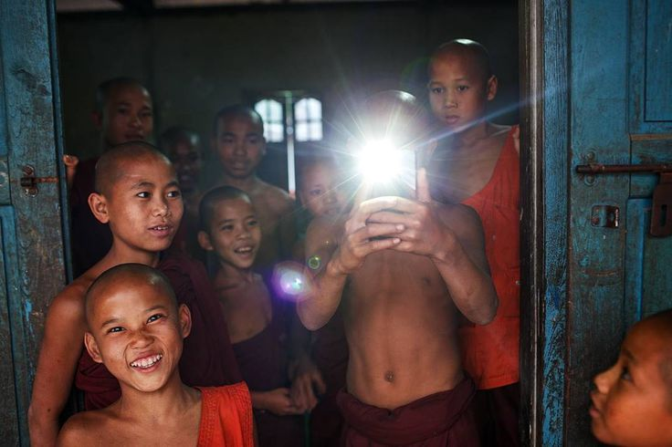A group of friendly monks with a mobile phone camera at a monastery in Lashio Shan state Myanmar. #myanmar #flash #adventure #travel #lashio by maciejdakowicz