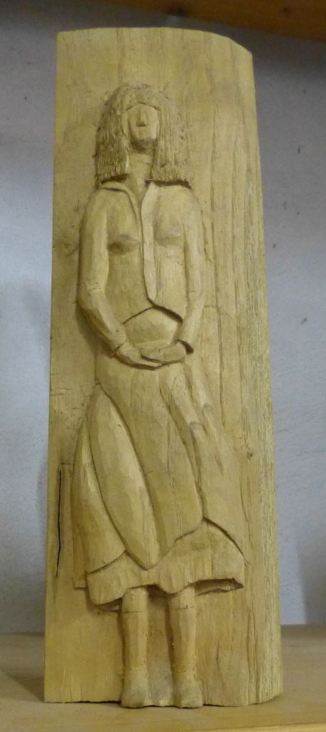 Turn Star, a surprisingly small figurine, you does not see the backside, oak, height 15cm, 2007.