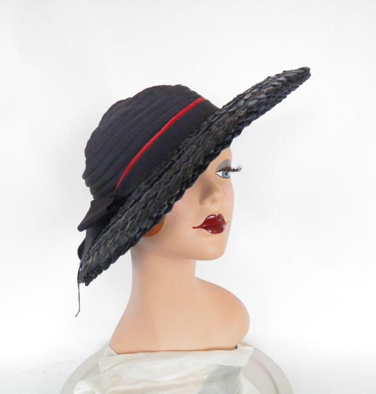 Womans 1940s Dobbs hat, navy blue Casablanca tilt by TheVintageHatShop on Etsy https://www.etsy.com/listing/215569100/womans-1940s-dobbs-hat-navy-blue