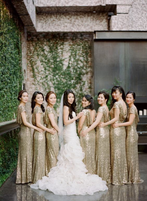 Glitter gold bridesmaid gowns: http://www.stylemepretty.com/little-black-book-blog/2016/02/16/glamorous-black-tie-wedding-at-the-foundry/   Photography: Rebecca Yale - http://rebeccayalephotography.com/: