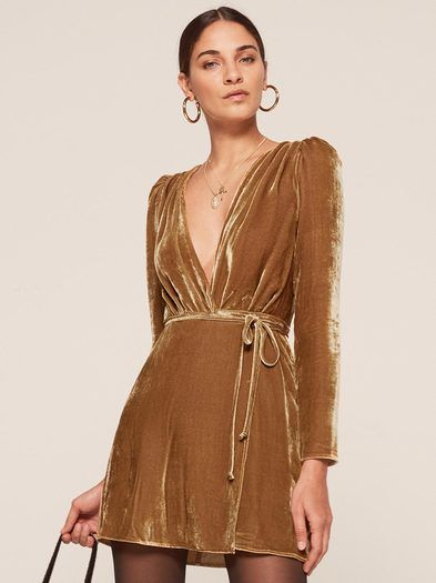 Some new stuff that's not linen or florals is here - #fallish.  This is a mini length, wrap dress with a deep v neckline and slightly puffed shoulders.