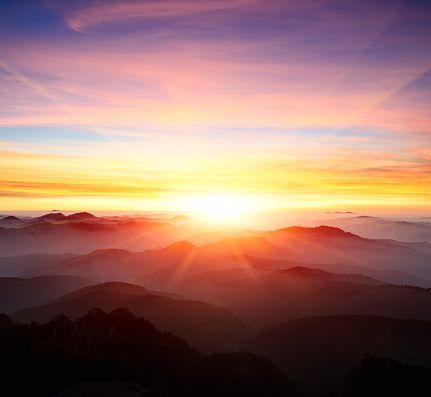 majestic sunrise over the mountains stock photo