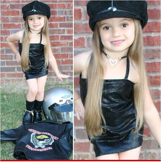 Halloween Biker Girl Costume- Why would you dress your child this way? There are sooo many better ways to do a girls biker costume!!