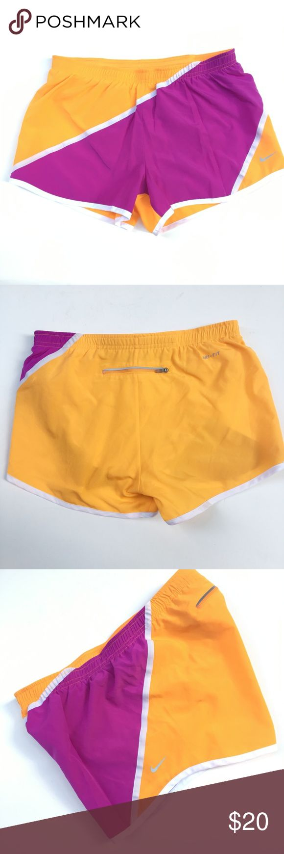 "Nike Running Shorts Nylon Dri Fit Pockets Orange Nike Women's Shorts Orange Fuschia Dri-Fit, Running Shorts, Mesh Built In Panties, Drawstring Elastic Waist, Reflective Swoosh, Diagonal Design. Interior Pocket for Keys.  Back Waist Zipper Pouch. Size: S Small  Waist: 14.25""  Inseam: 3"" Rise: 10.5""  Length: 10""  Condition: Very Good. Comes from a pet and smoke free environment!  Please review pictures and contact me if you have any questions. Color: Orange Fuschia Material: 100% Nylon…"