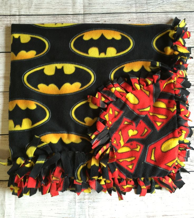 Superman vs batman logo hand tied fleece blanket. Comes in three sizes. https://www.etsy.com/listing/263139038/batman-vs-superman-no-sew-fleece-blanket