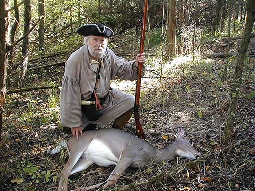 Colonial hunting with a Black-Powder Flintlock Long Rifle, Powder Horn, a Possible and a Powder Pouch.