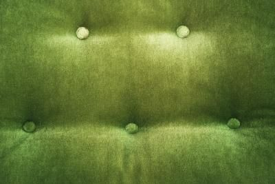 How to decorate around a dark green couch. I love ours, but always feel apprehensive about what I put on/around it...