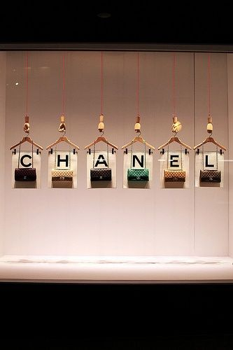Could hang letters from the ceiling on pendant lights. Would show up at night. Could potentially have different message on front and back. Great idea for sale sign