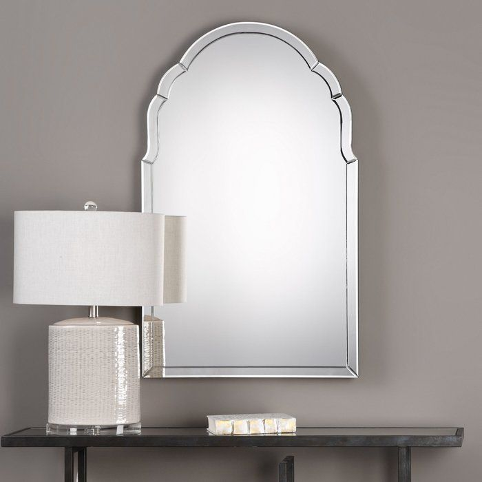 A timeless classic featuring an elegantly shaped arch. This frameless mirror is constructed of curved, hand beveled mirrors with a solid wood backing painted black. Perfect for any setting and will never go out of style.