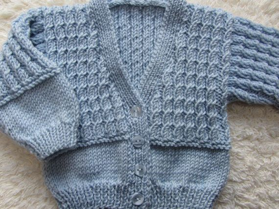 George  Hand knit baby cardigan in pastel blue with tiny cable twists, perfect for a little Prince aged 0-3 months. Free worldwide shipping from