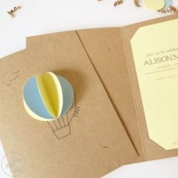 Learn how to make simple, affordable hot air balloon invitations perfect for a baby shower.