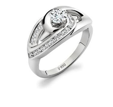 Platinum solitaire diamond ring with channel set circle of diamonds.