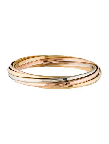 18K white, yellow and rose gold Cartier Trinity de Cartier rolling bangle featuring three yellow gold bangles, two white gold and two rose gold. Note: This item has been appraised and inspected by our certified gemologist. All diamond and gemstone grading is done under GIA standards as the mounting permits. All gemstone weights and measurements are approximate. Metal Type: 18K Yellow Gold, 18K White Gold, 18K Rose Gold Hallmark: 750, Brand Hallmark, Serial Number Signature: Cartier 12…