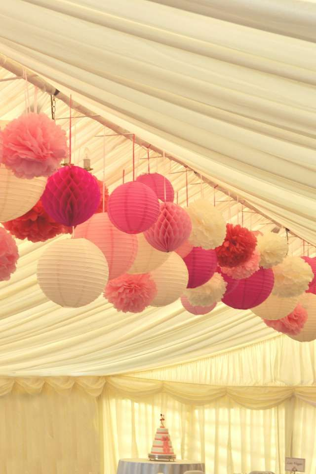 Multiple pink shades - paper lanterns, pom poms and honeycomb balls for a marquee wedding