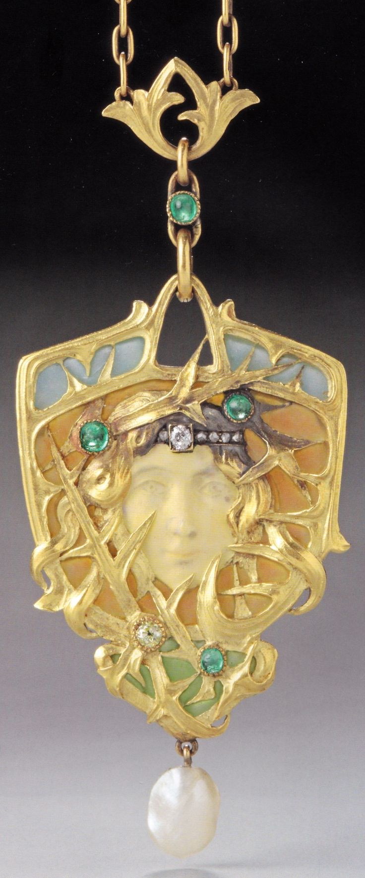An Art Nouveau gold, enamel, diamond, emerald and baroque pearl pendant, Paris, circa 1900. Previously attributed to Mucha / Fouquet. Source: Wolfgang Glüber, Jugendstilschmuck #ArtNouveau #pendant