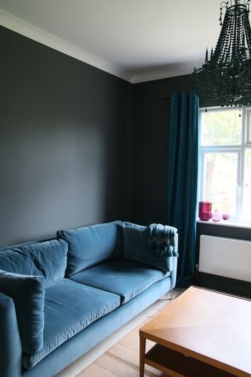 down pipe with blue velvet sofa