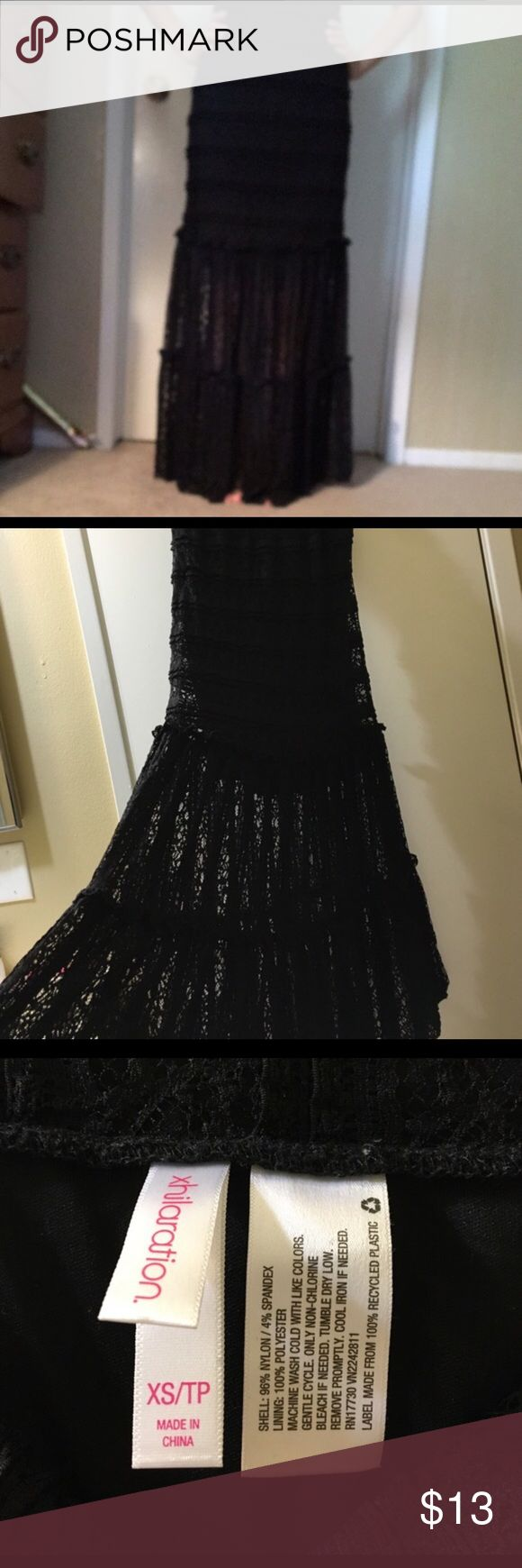 Lace maxi skirt Black laced maxi skirt. Has a liner underneath that goes right at or above the knee. Outter part of the skirt is completely laced. Xhilaration Skirts Maxi