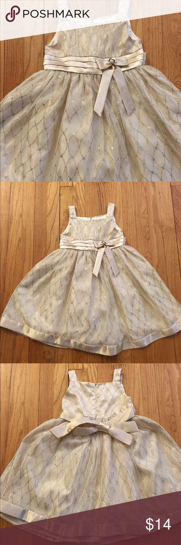 Beautiful Sparkly dress This gorgeous dress was worn once and is in perfect shape. Size 5 girls. Cream dress with lovely silver and gold gems that sparkle. Tie dash in back. LOVE Dresses Formal