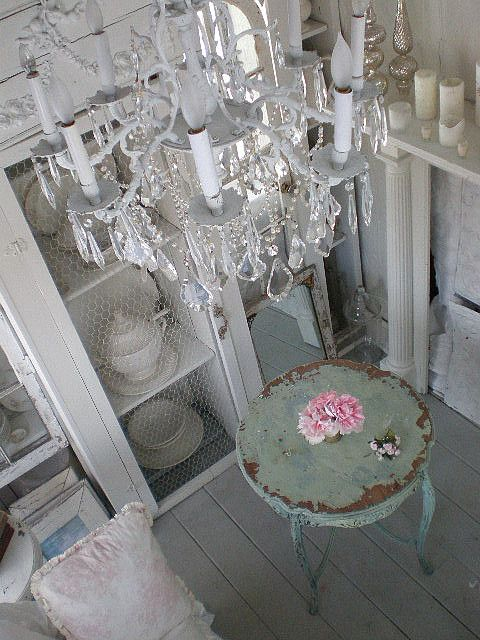 Shabby Chic table, flowers and chandelier.