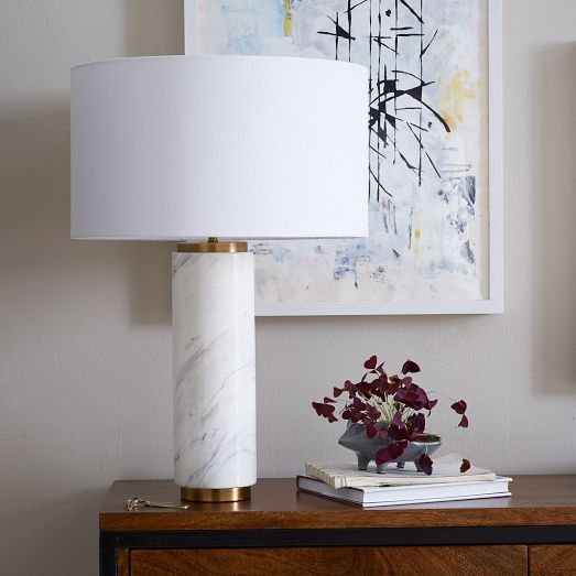 Featuring a marble-finished base and white linen shade, the Pillar Table Lamp looks right at home in a mid-century room. Its size and scale are perfect for a nightstand or entryway console.
