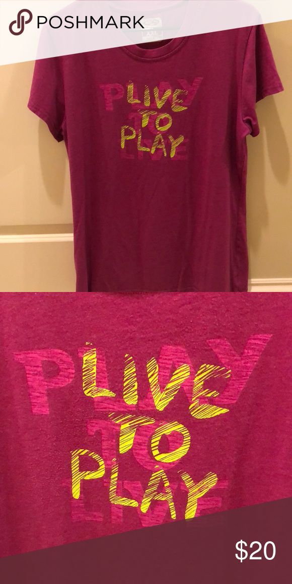 CHAMPION PINK SHORT SLEEVE TOP This Champion hot pink short sleeves tee shirt has a great message on it. PLAY TO LIVE, LIVE TO PLAY. Sometimes we just have to play. 👏🏻😎✌🏼 Never been worn. No flaws or stains.  SMOKE FREE AND PET HOME 🏡 Champion Tops Tees - Short Sleeve