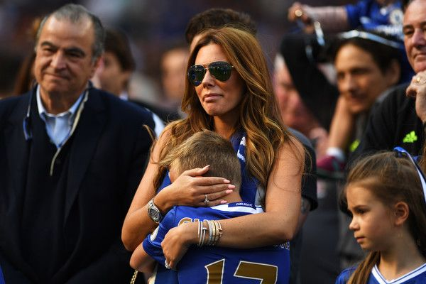 Toni Terry, wife of John Terry of Chelsea comforts their son Georgie Terry during the Premier League match between Chelsea and Sunderland at Stamford Bridge on May 21, 2017 in London, England.