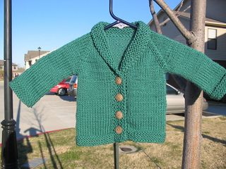 Aran knit in stocking stitch/garter stitch for 0-3 months and 6-12 months.