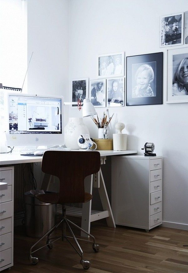 studio - with black and white photos in the wall