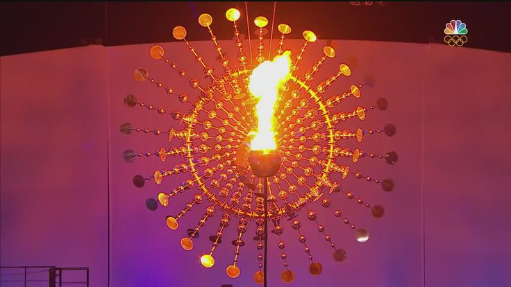 After former Brazilian marathoner Vanderlei de Lima lights the Olympic flame, the cauldron makes its final ascent, kicking off the Rio Games.