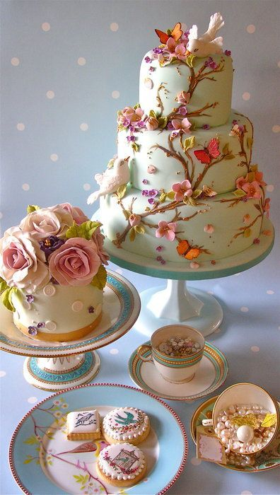 "Stunning wildlife inspired wedding cake, birds, flowers and butterflies - makes me think of a fairy themed wedding, or ""fantasy"" with lots of trees and branches and fairies and secrets."