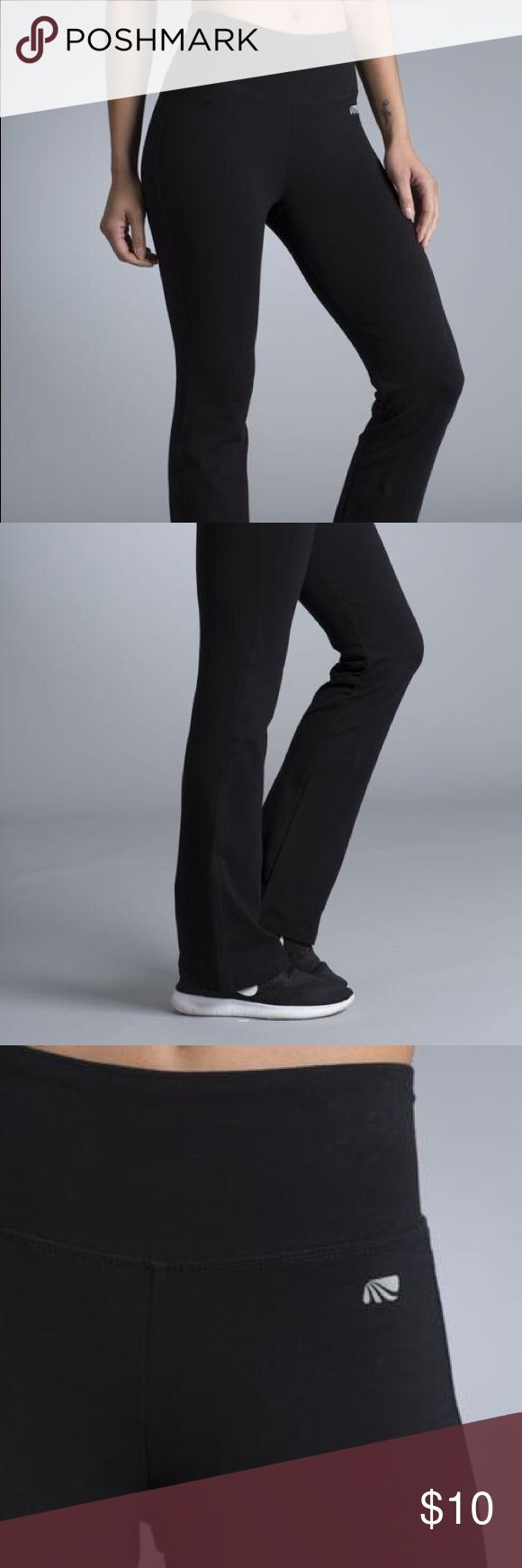 Marika Magic Performance Yoga Pants black marika magic performance tummy control yoga boot leg pants, stretch cotton blend fabric with power mesh at the waistband for tummy control, machine wash. logo is slightly coming off and words on the label are no longer decipherable, otherwise great condition. bottom part may be a little wider than stock photo Marika Pants Boot Cut & Flare