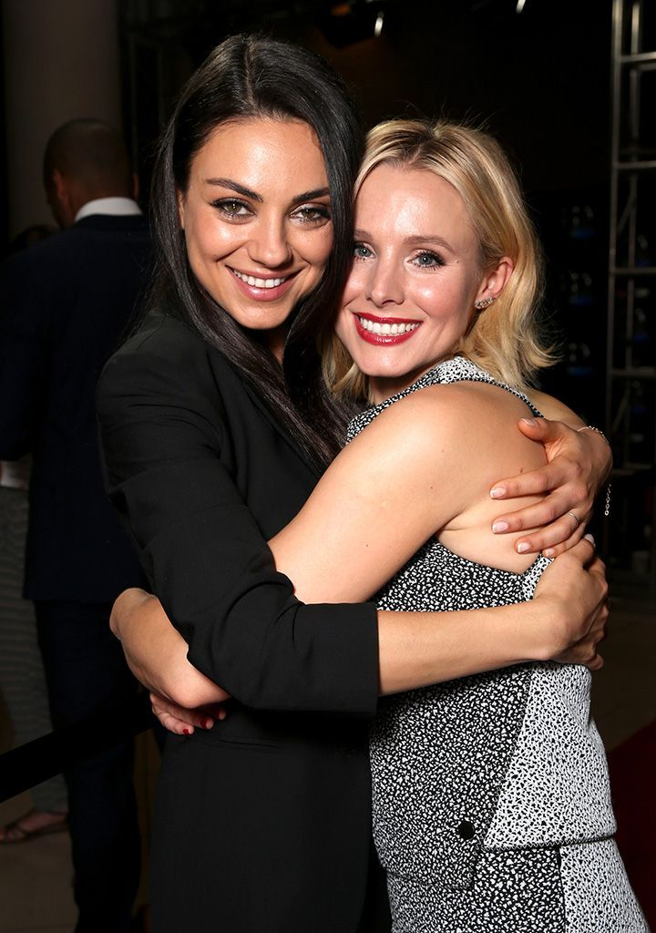 Hot Mamas Mila Kunis and Kristen Bell, stars of the upcoming comedy Bad Moms, hugged for the cameras at CinemaCon, the convention of the National Association of Theatre Owners, in Vegas. Their movie about competitive parenting is set to hit theaters July 29. (Photo: Todd Williamson/Getty Images for CinemaCon)