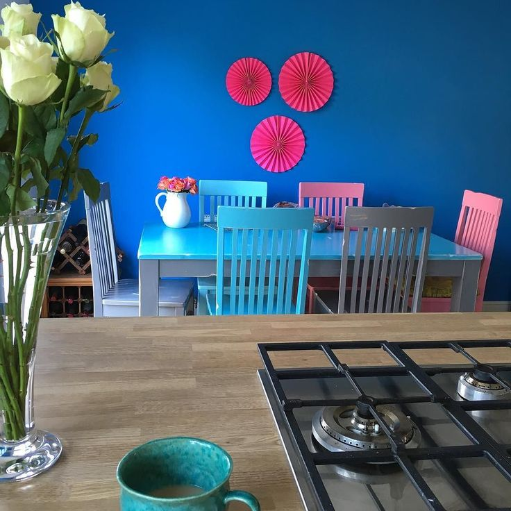 Our new colourful kitchen/diner space with Smeg hob inset into worktop and upcycled chair and table painted with chalk paint